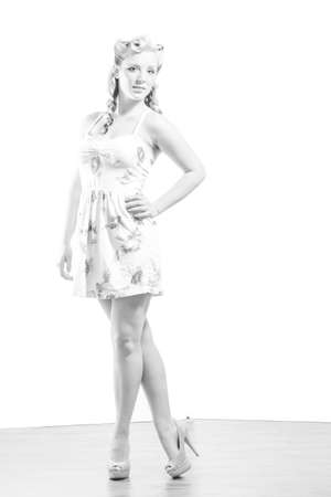 Young attractive woman in short modest dress on isolated white background photo