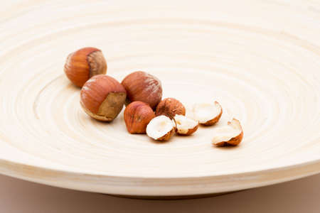 unsaturated fat: Shelled and unshelled Hazelnuts served on a dish Stock Photo