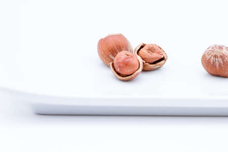 unsaturated fat: Shelled and unshelled Filbert nuts served on a dish Stock Photo