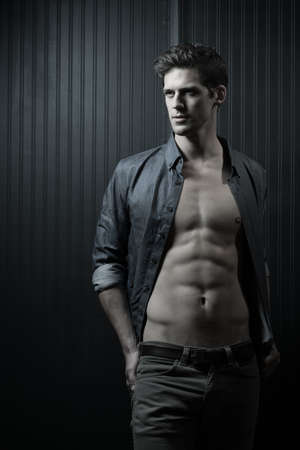 washboard: Slender Male With Shirt Open Exposing Washboard Abs