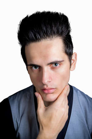 chin: Cute Dark Hair Green Eye Male With Hand On Chin Stock Photo