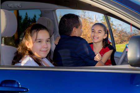 Dad Hugs Daughter At Car Before Cheerleader Practice Archivio Fotografico