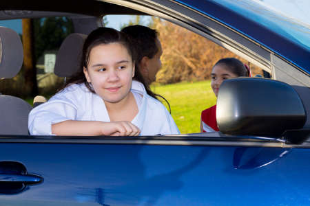 errands: Daughter Waits Patiently As Dad Sends Off Sister To Cheerleader Practice