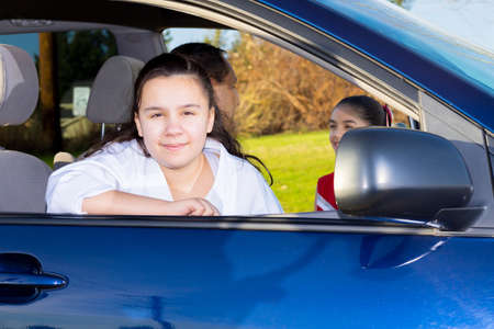 Daughter Waits Patiently As Dad Sends Off Sister To Cheerleader Practice