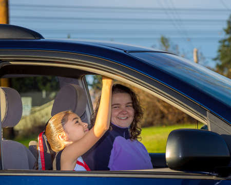 errands: Loving Mom Takes Daughter To Practice Stock Photo