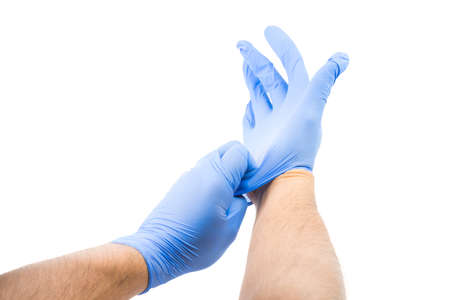 Male Putting On Powder Free Latex Gloves