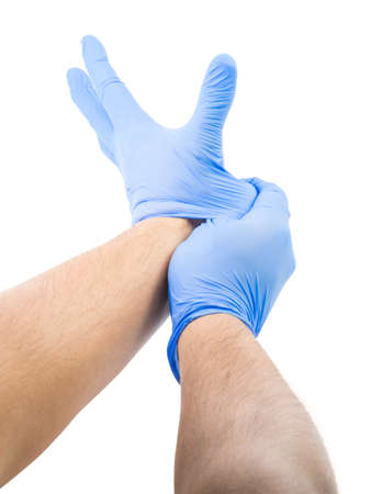 latex glove: Male Stretching And Fitting Latex Glove Stock Photo