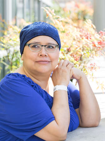 Latina Female Breast Cancer Patient Wearing Medical Wrist Band