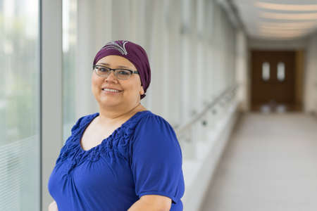 Woman diagnosed with cancer wearing a fashionable hair cap