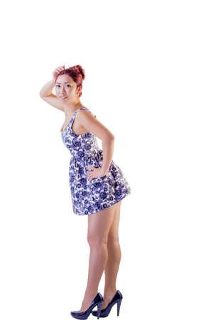velvet dress: Asian female with velvet hair color in high heels and short dress on isolated background