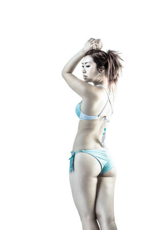 two piece: Asian female wearing two piece swimsuit on isolated white background