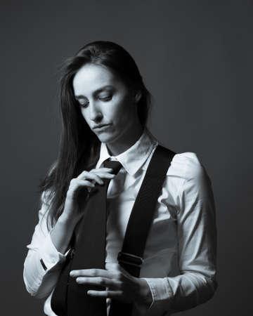Slender caucasian female editorial style portrait of masculinity