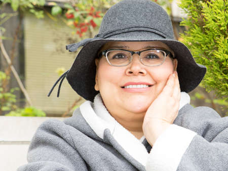 cancer treatment: Hispanic woman dealing with breast cancer treatment keeps an upbeat and happy disposition Stock Photo