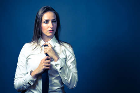 to button up: American female wearing a whtie button up shirt with a black tie