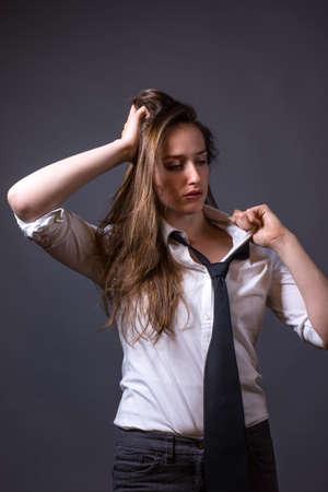 loose: Slender Feminine Female Wearing Loose Black Tie
