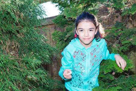 explores: Young female child plays and explores outdoors