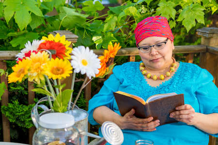 radiation therapy: Latina female enjoys relaxing time reading out on patio
