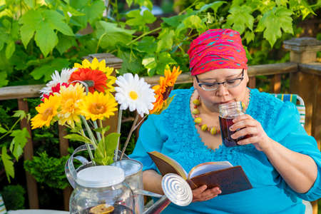 radiation therapy: Hispanic woman enjoys an evening snack and drink on outside deck