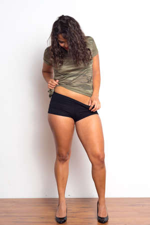olive skin: Curvy young woman with curly hair and olive skin Stock Photo