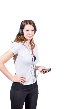 american downloads: Caucasian female wearing headphones and holding audio device