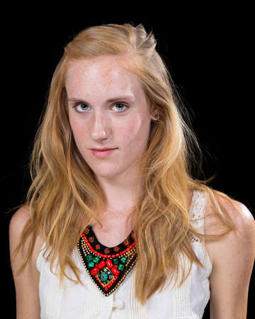 double chin: Young caucasian female expression portrait isolated on black background