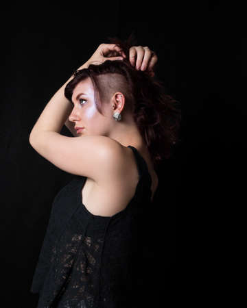 proportionate: Female with trendy haircut, full lips, and colored hair. Stock Photo