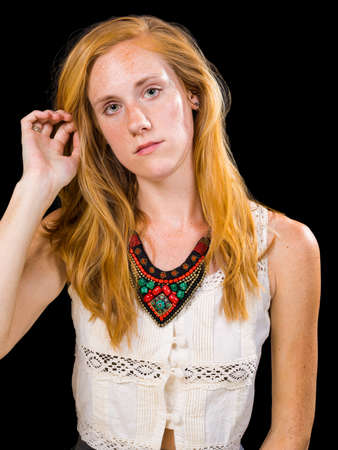 strawberry blonde: Attractive strawberry blonde hair and blue eyes female on isolated black background Stock Photo