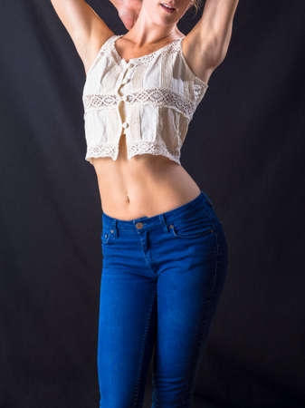 women's issues: Young caucasian female slender and curvy body wearing jeans. Stock Photo