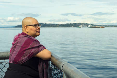 fighting cancer: Beautiful woman reflects upon her recent breast cancer surgery Stock Photo