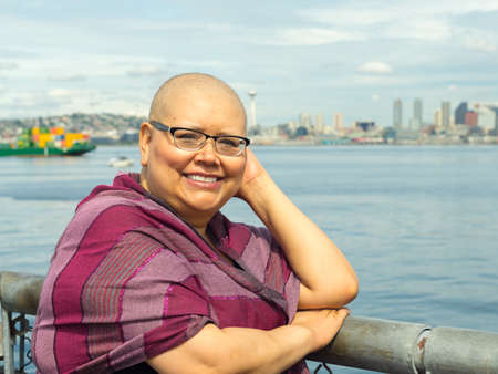 Beautiful woman reflects upon her recent breast cancer surgery Stock Photo