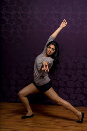 Young Indian woman performing dance in studio 版權商用圖片