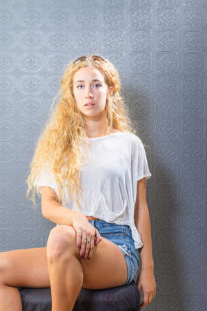 olive skin: All-American girl next door wearing tee and shorts Stock Photo