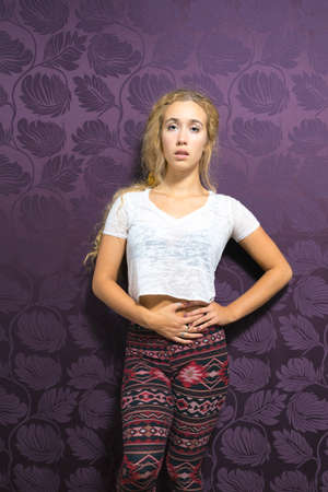 coed: Caucasian female wearing leggings and crop top fashion portrait