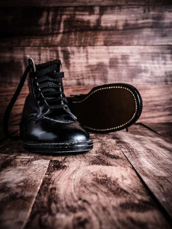 worn: Young Boys Worn Leather Boots Stock Photo