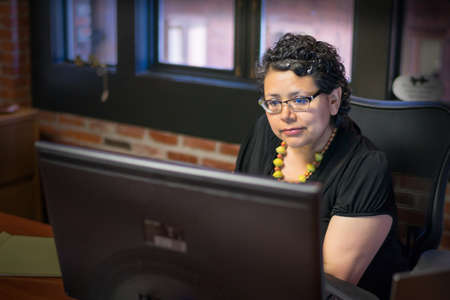 energized: Professional Latina Working At Office