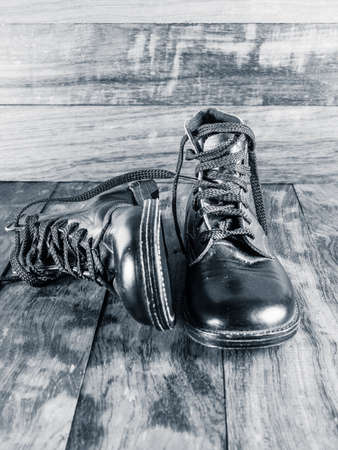 leather boots: Young Boys Worn Leather Boots Stock Photo