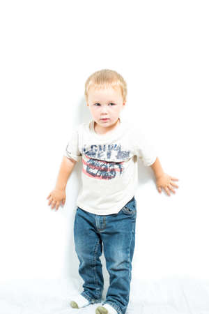 fair skin: Young Shy American Blond Boy Stock Photo