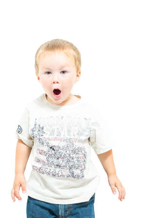 twos: Young Boy Makes Shocked Facial Expression Stock Photo