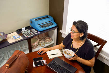 Hispanic Woman Working From Home Archivio Fotografico