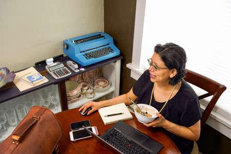 Hispanic Woman Working From Home Stok Fotoğraf