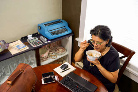 Hispanic Woman Working From Home Archivio Fotografico