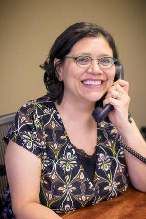 Gen-X Woman Works At Office Desk Stok Fotoğraf