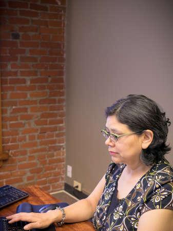 Hispanic Woman Doing Her Job
