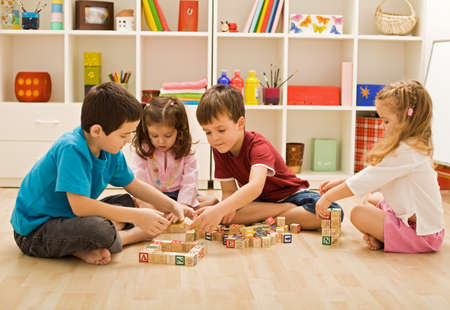 Children playing with blocks on the floor - focus on the boys face