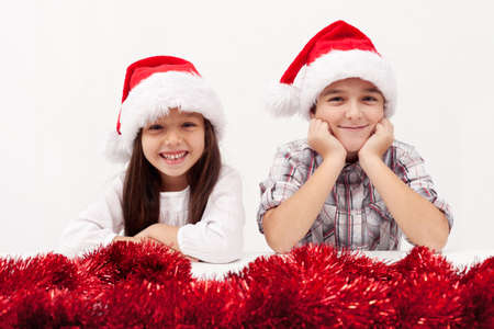 Christmas kids with red garland smiling white baclground Stock Photo