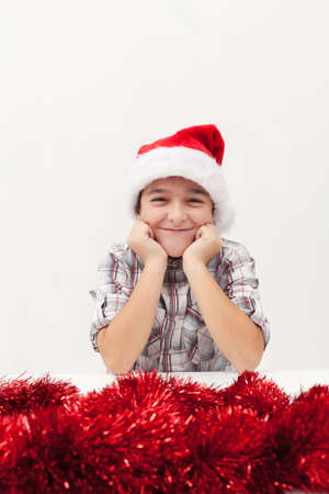 Finally - christmas is here - happy boy smiling joyfully