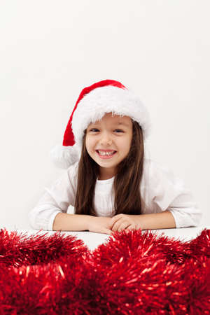 Little christmas girl with a big grin on white copy space