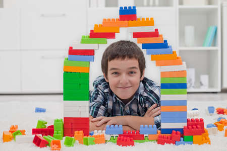 Happy little boy playing with blocks Stock Photo - 16971092
