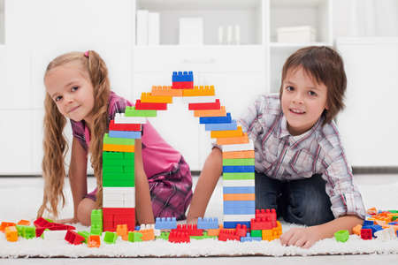 Happy children among of colorful blocks Stock Photo