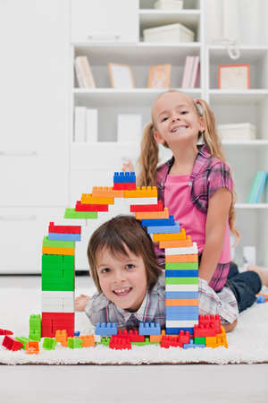 Happy children among the blocks - focus on the boy Stock Photo - 16971098